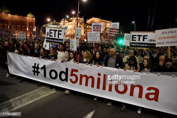 Protesters hold a banner reading 1 out of 5 millions during a demonstration against Serbian President in Belgrade on March 9 2019 Since early...