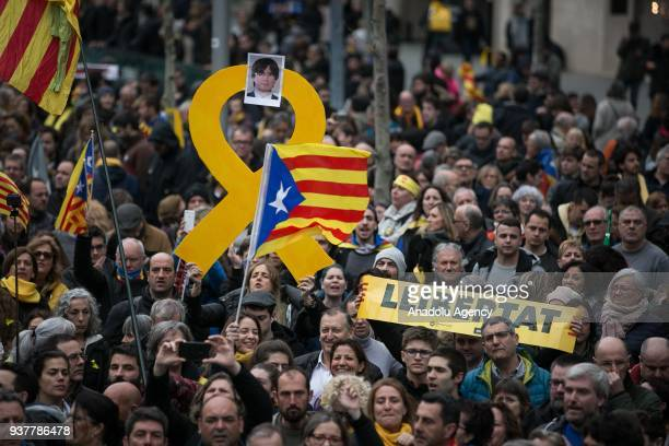 Protesters hold a banner reading 'Freedom' while waving pro-independence Catalan Esteleda flags during a demonstration outside the EU Commission...