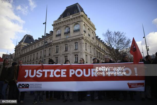 Protesters hold a banner reading 'Justice for Theo' during a demonstration against police brutality on February 18 2017 on the place de la Republique...