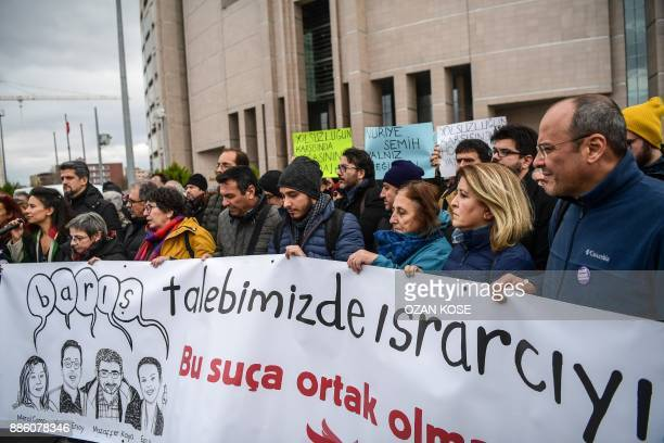 Protesters hold a banner reading We insist on our demandwe will not be a partner in thiscrimePeace Academics on December 5 2017 in front of...