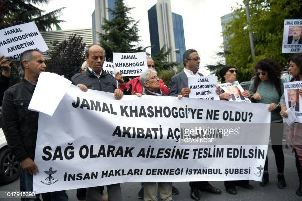 Protesters hold a banner reading We need an explanation of what happened to Jamal Kashoggi during a demonstration in support of missing journalist...