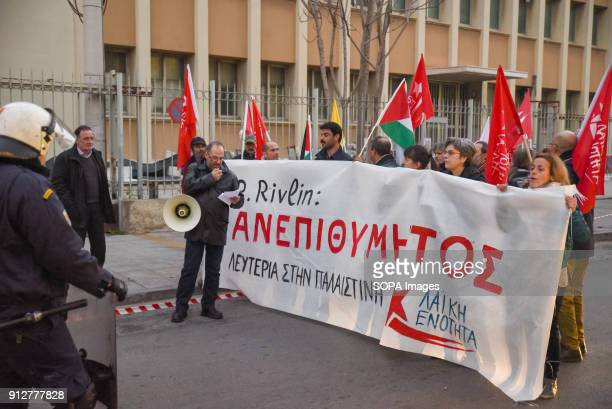Protesters hold a banner that reads 'Not Welcome' against the visit of Israeli President Reuven Rivlin in Athens