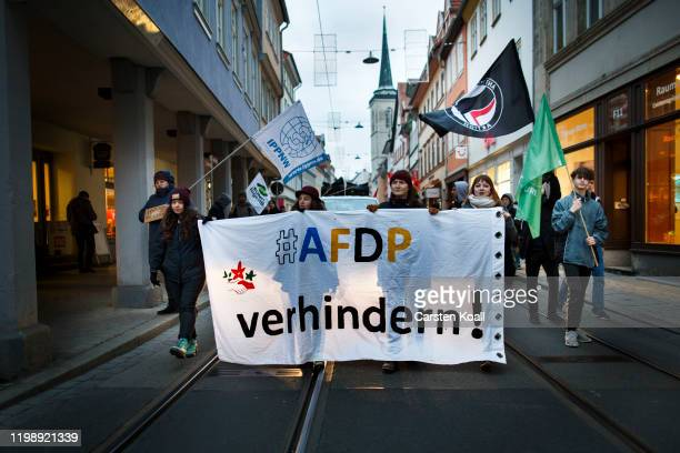 """Protesters hold a banner with the slogan """"AFDP prevent"""" during a demonstration against the right-wing Alternative for Germany political party bedause..."""