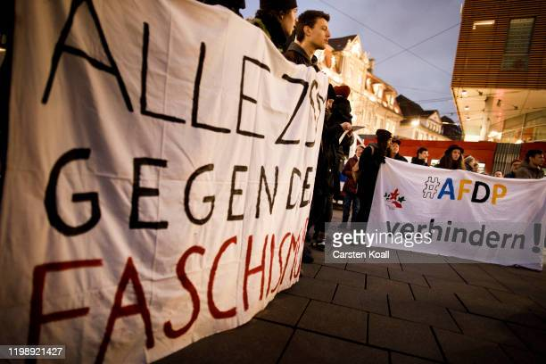 Protesters hold a banner with the slogan AFDP prevent during a demonstration against the rightwing Alternative for Germany political party bedause...