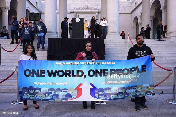 Protesters hold a banner written 'One world one people' on it as hundreds of Californians mostly including Muslims gathered during a protest against...
