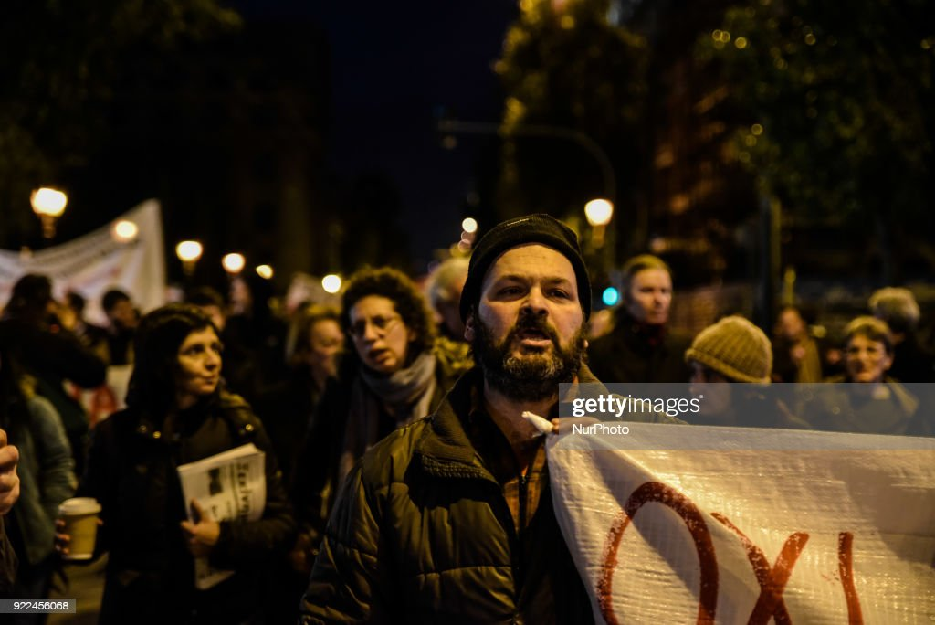 Protesters hold a banners and placards as they take part in a demonstration against property foreclosure auctions in Athens, Greece, February 21, 2018.
