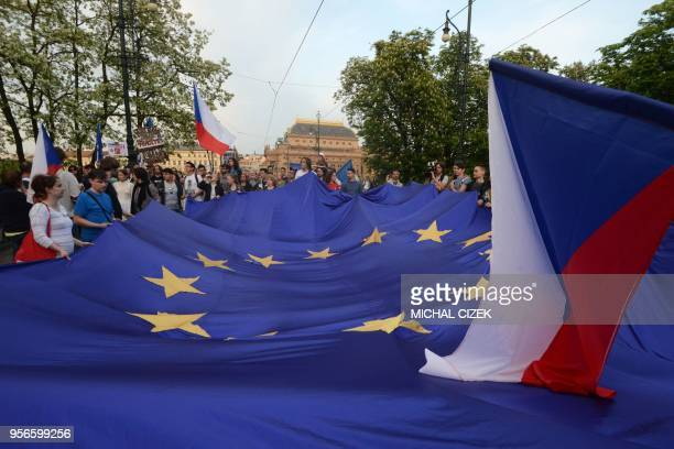 Protesters hold a big flag of the European Union and the Czech flag during an anti government rally on April 9 2018 in Prague