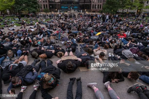 Protesters hold a die-in as they gather peacefully to protest the death of George Floyd at the State Capital building in downtown Columbus, Ohio, on...