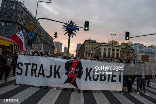 Protesters hold a massive banner of Women's Strike during the protest. Thousands of people took to the streets of Poland for a fifth straight day of...
