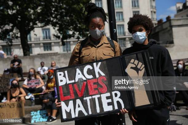 Protesters hold a placard during a Black Lives Matter rally gathering at Marble Arch ahead of a march towards Downing Street in London United Kingdom...