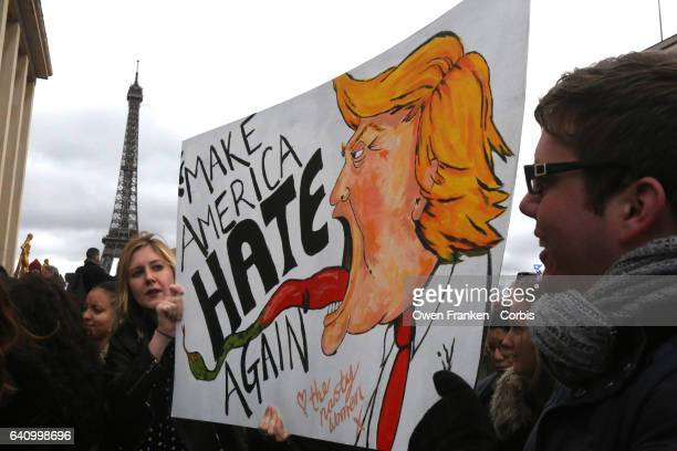 Protesters hold a placard during a demonstration against Donald Trump on Trocadero on February 4 2017 in Paris France After US President Trump signed...