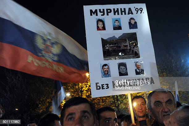 Protesters hold a placard showing pictures of victims of the 1999 NATO bombing campaign during a protest in Podgorica on December 12 2015 Several...