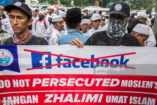 Protesters hold a poster during the demonstration Hundreds of muslims from Indonesian Islam defender and some underbow muslim organization held...