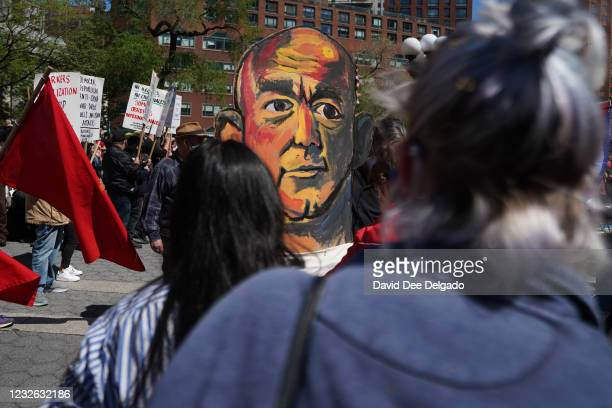 Protesters hold a puppet of Amazon CEO Jeff Bezos during a May Day protest on May 1, 2021 in New York City. Across the country people are protesting...