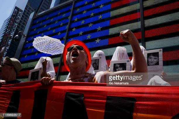 Protesters hold a rally against gun violence in Times Square in response to recent mass shootings in El Paso, Texas and Denton, Ohio on August 4,...