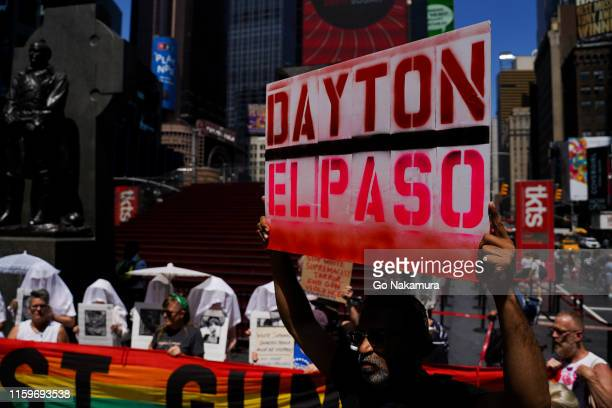 Protesters hold a rally against gun violence in Times Square in response to recent mass shootings in El Paso Texas and Denton Ohio on August 4 2019...