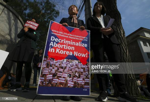 Protesters hold a rally against South Korea's abortion laws outside the constitutional court in Seoul on April 11 2019 South Korea's constitutional...