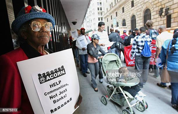 Protesters hold a rally calling on the Federal Reserve to bail out homeowners in addition to Wall Street firms outside the Federal Reserve Bank of...