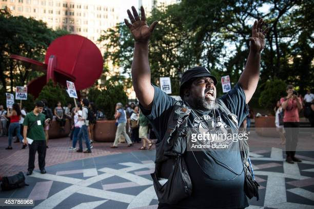 Protesters hold a rally in solidarity with the people of Ferguson Missouri protesting the death of Michael Brown and the excessive use of force by...