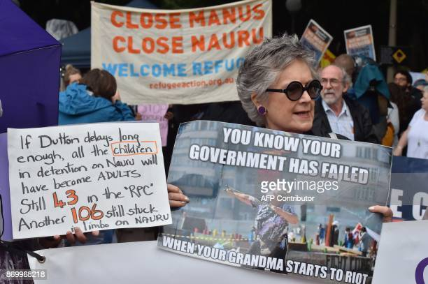 Protesters hold a rally in Sydney to urge the Australian government to end the refugee crisis on Manus Island on November 4 2017 The United Nations...