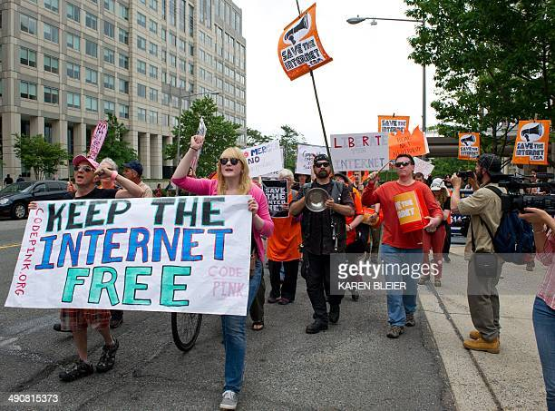Protesters hold a rally to support 'net neutrality' and urge the Federal Communications Commission to reject a proposal that would allow Internet...