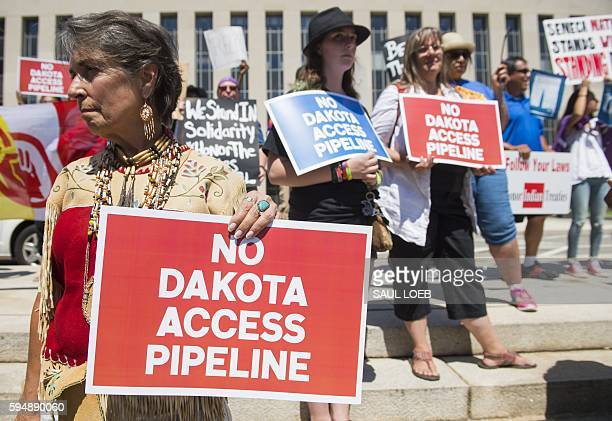 Protesters hold a rally with the Standing Rock Sioux tribe in support of a lawsuit against the Army Corps of Engineers and plans for the Dakota...