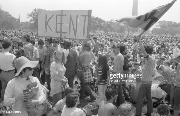 Protesters hold a sign reading Kent referring to Kent States during a student strike and protest against the Vietnam War on the National Mall in...