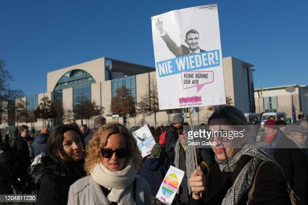 Protesters hold a sign showing Bjoern Hoecke leader of the rightwing Alternative for Germany in the German state of Thuringia during a demonstration...