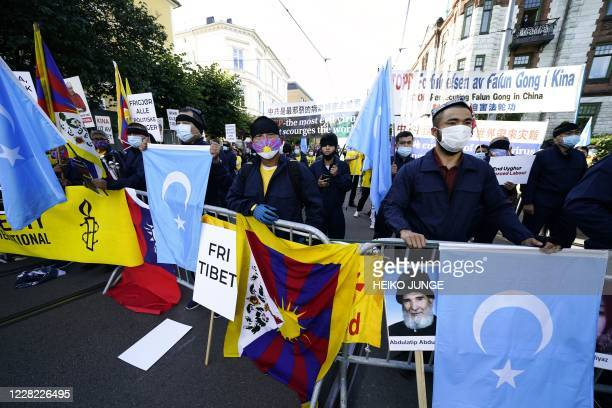 Protesters hold a Tibetian flag during a demonstration during a visit of Chinese Foreign Minister Wang Yi to Norway on August 27 2020 in Oslo /...
