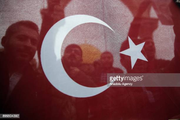 Protesters hold a Turkish flag during a demonstration against US President Donald Trumps announcement to recognize Jerusalem as the capital of Israel...