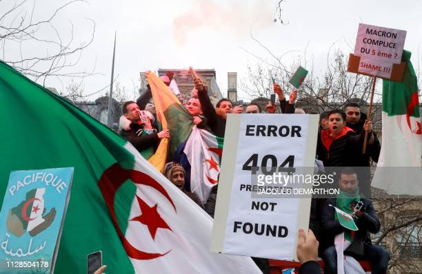 Protesters hold Algerian national flags during a rally against ailing Algerian president's decision to stand for a fifth term in office on March 3 in...