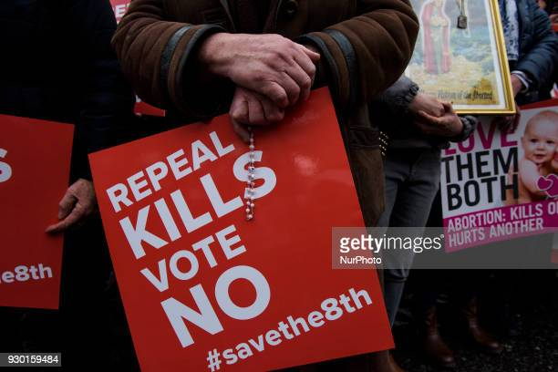 Protesters hold an antiabortion placards during the AllIreland Rally for Life march to Save the 8th amendment to the Irish constitution which...