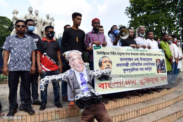 Protesters hold an effigy of the Israeli Prime Minister Benjamin Netanyahu and a banner during the demonstration. Bangladeshi Muktijuddho Moncho...