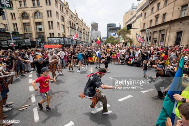 Protesters hold an imprumptu Indigenous Brolga Dance on Broadway looking down onto the city CBD on January 26 2018 in Sydney Australia Australia Day...