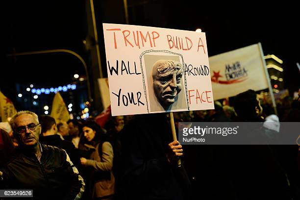 Protesters hold antiTrump banners during a demonstration against US president Obama visit in Athens Greece on November 15 2016