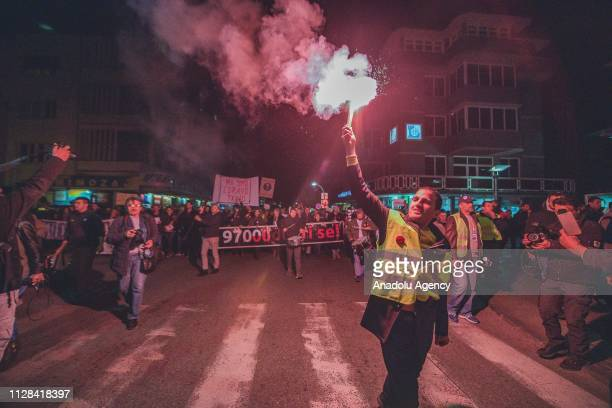 Protesters hold banners and light torches during a protest staged by Citizens' Movement 97000 Odupri Se demanding the resignations of Montenegrian...