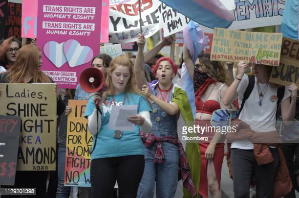 Protesters hold banners and placards during a rally on International Women's Day in Melbourne, Australia, on Friday, March 8, 2018. The United...