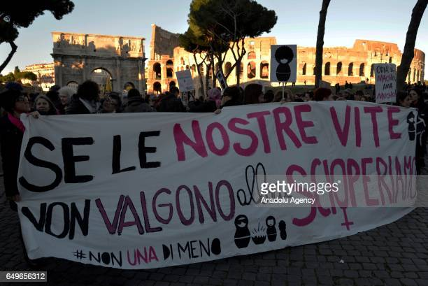 Protesters hold banners as they march during a demonstration named 'No One Less' which is held to protest violence against women as part of the...