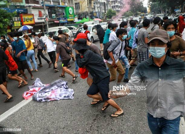 Protesters hold banners as they take part in a demonstration against the military coup and to mark the anniversary of 1962 student protests against...