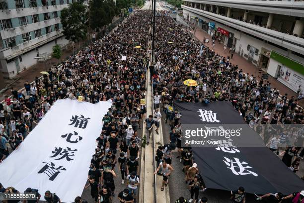 Protesters hold banners as they take part in a prodemocracy march on July 14 2019 in Hong Kong China Thousands of protesters marched in Sha Tin...