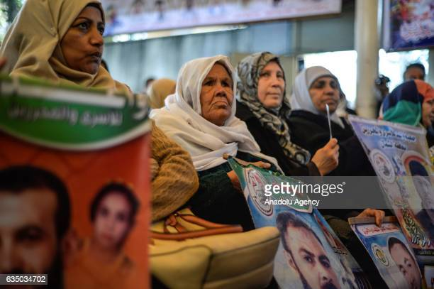 Protesters hold banners during a demonstration demanding the release of the Palestinians held in Israeli prisons in front of the International Red...