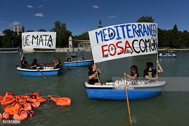 Protesters hold banners during a protest in Madrid in support of refugees and migrants An estimated 100 people gathered at 'Retiro' park in Madrid in...