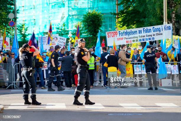 Protesters hold banners during a protest linked to a visit of Chinese Foreign Minister Wang Yi to Norway on August 27 2020 in Oslo / Norway OUT