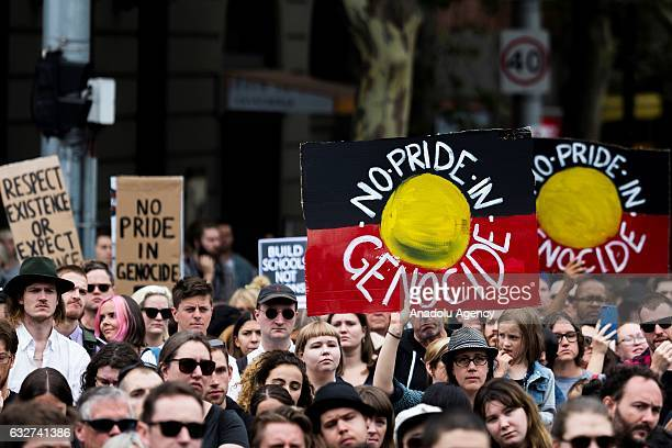 Protesters hold banners during a protest organized by Aboriginal rights activists on Australia Day in Melbourne Australia on January 26 2017...