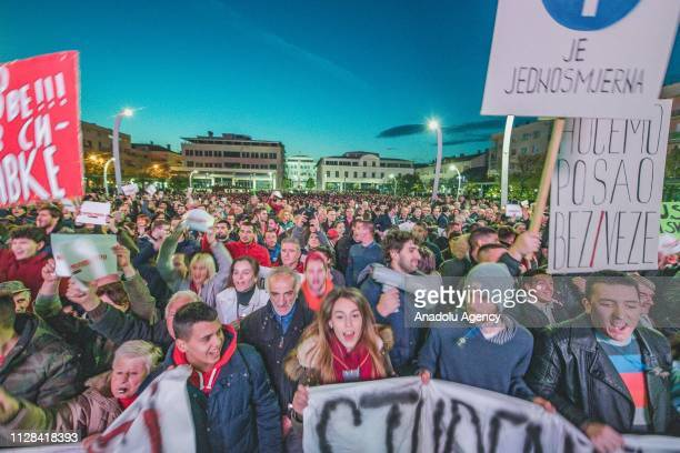 Protesters hold banners during a protest staged by Citizens' Movement 97000 Odupri Se demanding the resignations of Montenegrian President Milo...