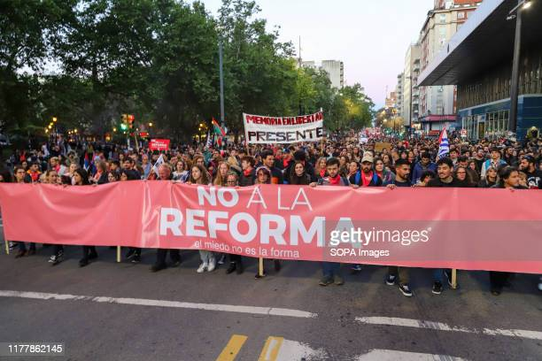 Protesters hold banners during the no to the reform march in Montevideo. People march against the constitutional reform project which proposes a...