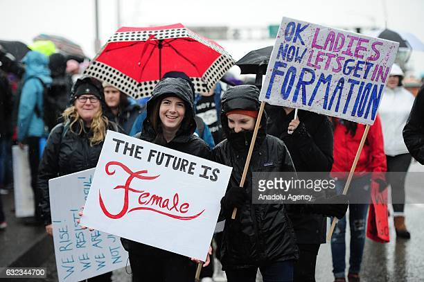 Protesters hold banners during the Women's March On Portland in Portland Oregon USA on January 21 2017 Tens of thousands gathered to show solidarity...