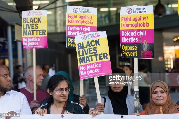 Protesters hold banners reading Black Lives Matter No Justice No Peace Fight Against Islamophobia Defend Civil Liberties Oppose Prevent Jobs and...