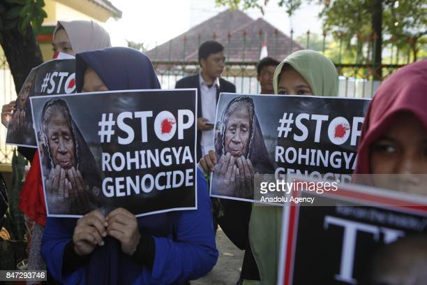 Protesters hold banners reading '#Stop Rohingya Genocide' during a demonstration in support of Rohingya Muslims outside of Myanmar Embassy in Jakarta...
