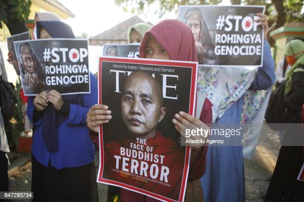 Protesters hold banners reading 'The Face of Buddhist Terror with the image of Myanmar Buddhist Monk Wirathu #Stop Rohingya Genocide' during a...